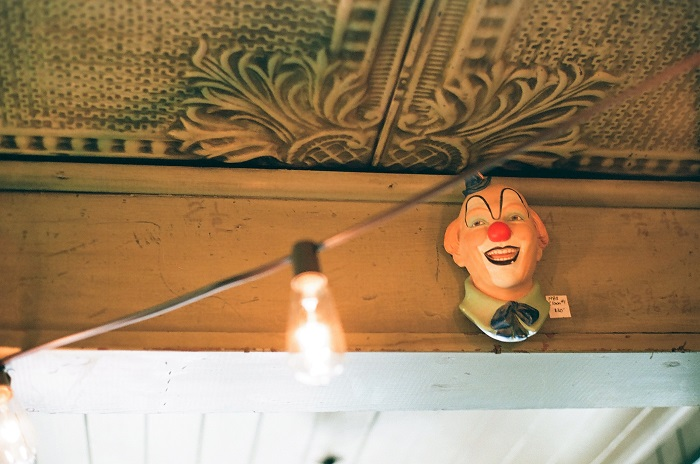Clown figurine hanging on a wall