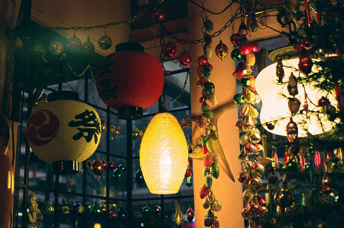 Lanterns and Christmas ornaments in a window